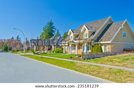 Nice and comfortable neighborhood. Line of the houses, homes on the empty street in the suburbs of Vancouver Canada. - stock photo