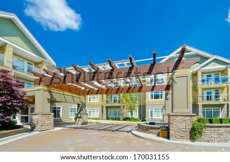 Nice and comfortable neighborhood. Modern designed entrance to the new row of townhouses  or condominiums in the suburbs of Vancouver. Canada. - stock photo