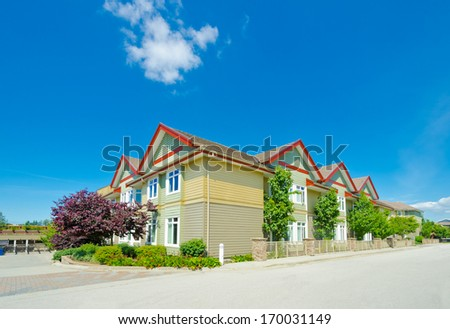 Nice and comfortable neighborhood. New townhouses  or condominiums in the suburbs of Vancouver. Canada. - stock photo