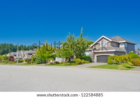 Nice and comfortable neighborhood. Some homes in the suburbs of the North America. Canada. - stock photo