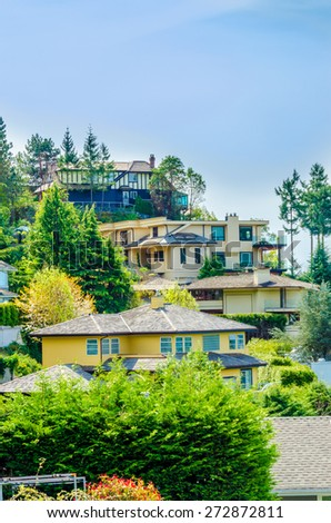 Nice and comfortable neighborhood. Some homes on the hills in the suburbs of the North America. Canada. Vertical. - stock photo