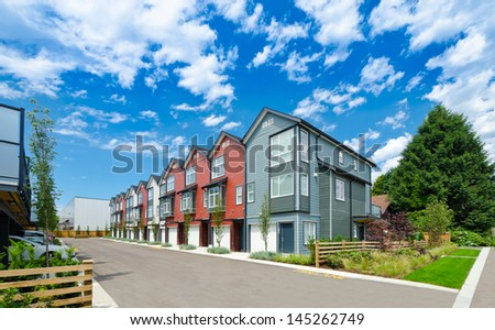 Nice and comfortable neighborhood. Townhouses in the suburbs of the North America. Canada. - stock photo