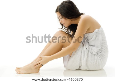 nice and young woman in bathrobe taking care of herself on white background - stock photo