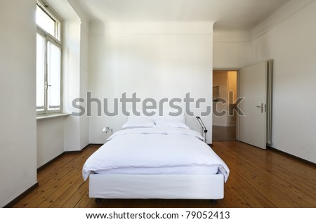 nice apartment refitted, bedroom with a double bed - stock photo