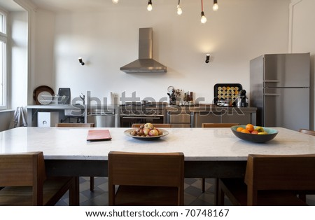 nice apartment refitted, kitchen view with appliances in style - stock photo