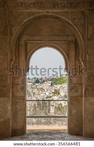 Nice arch door in ancient Arabian palace Alhambra. Granada, Spain. - stock photo