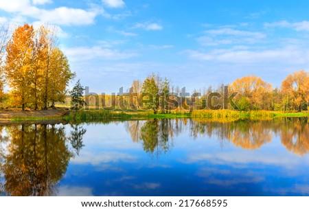 Nice autumn scene on lake - stock photo