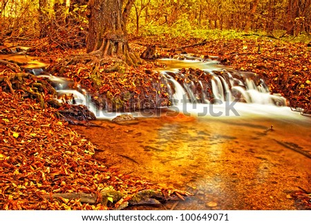 Nice autumnal scene with waterfall - stock photo