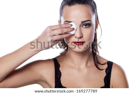 nice beautiful girl removes her make-up using cotton pad - stock photo