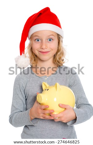 nice blond girl with Santa- cap and piggy bank  - stock photo