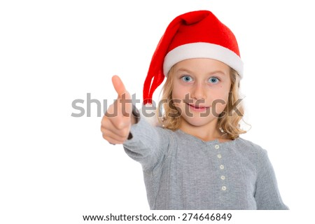 nice blond girl with Santa- cap and thumb up - stock photo