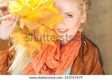 Nice blonde girl in autumn park - stock photo