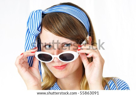 nice blue-eyed woman with sunglasses on white background - stock photo