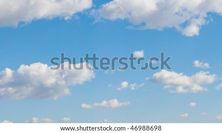 Nice blue sky with a few white clouds - stock photo