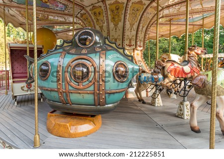 Nice blue submarine of a carousel in a kids park - stock photo