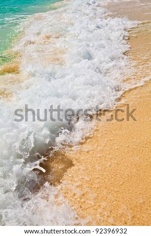 Nice blue water ripples near a shore in the Indian Ocean, Maldives - stock photo