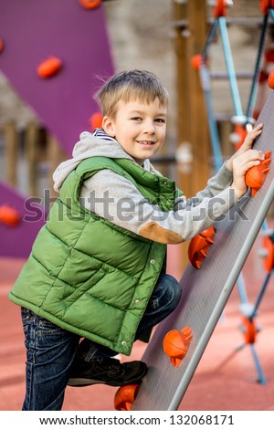 Nice boy at a playground in a sunny day