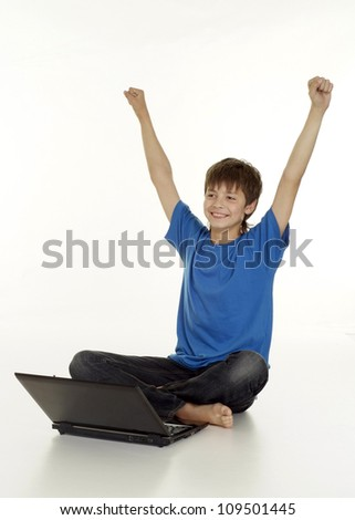 Nice boy in blue T-shirt on a white background - stock photo