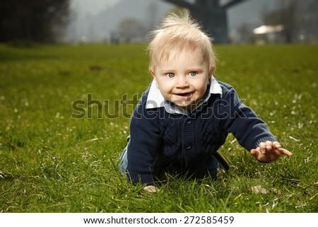 Nice boy in park - stock photo