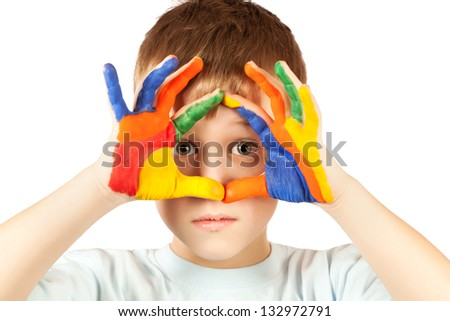 nice boy with stained coloured hand. isolated