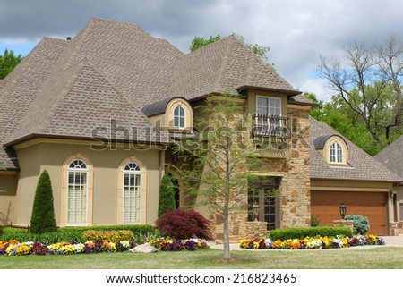Nice brick house with pretty landscaping - stock photo