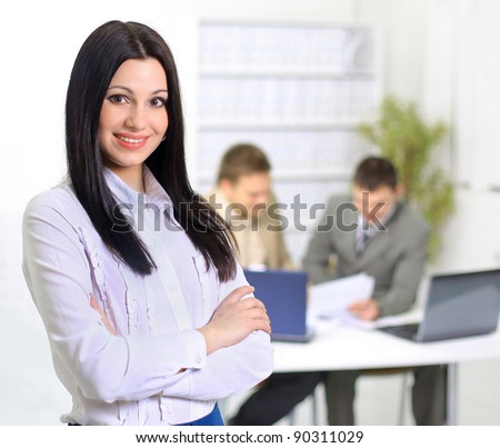 Nice business woman. On the day of plan discussion of the employees of the work plan.