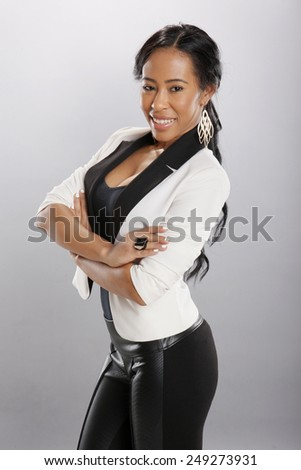 Nice caribbean girl in fashionable attire - stock photo