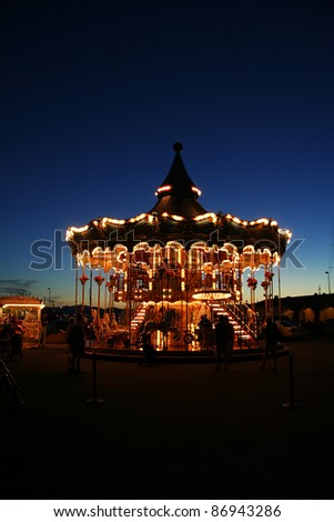 Nice Carousel with dark sky in the evening - stock photo