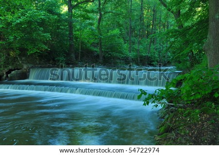 nice cascade in green forest - stock photo