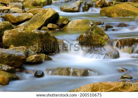 Nice cascade of mountain brook - stock photo