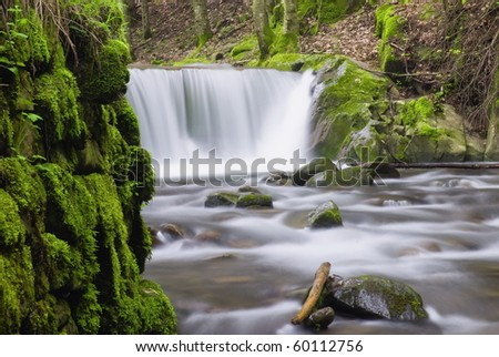 nice cascade view from the riverbed - stock photo