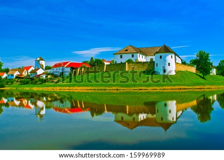 nice castle with water reflection - stock photo