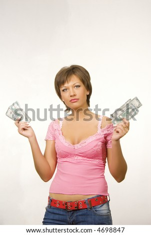 Nice caucasian female holding dollars in her hands