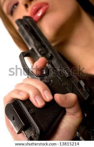 Nice caucasian girl with a gun - stock photo