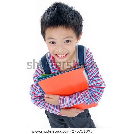 Nice child holding a book standing - stock photo