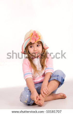 Nice child sitting on the floor - stock photo