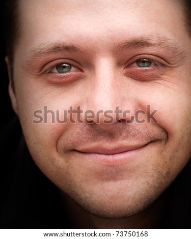 Nice closeup  portrait of young smilling man - stock photo