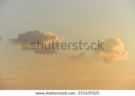Nice clouds in sunset sky - stock photo