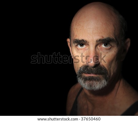 Nice color Image of a Balding Older Man On Black - stock photo