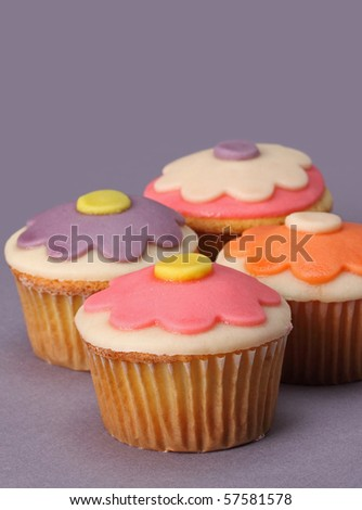nice colorful cupcakes with marzipan topping - stock photo