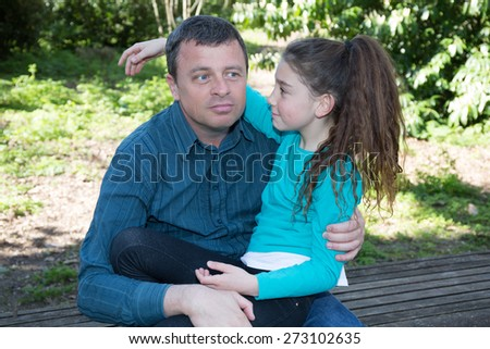 Nice complicity between a father and his daughter - stock photo