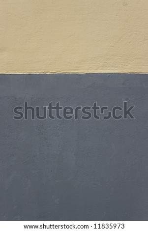 Nice concrete wall painted with yellow & gray - stock photo
