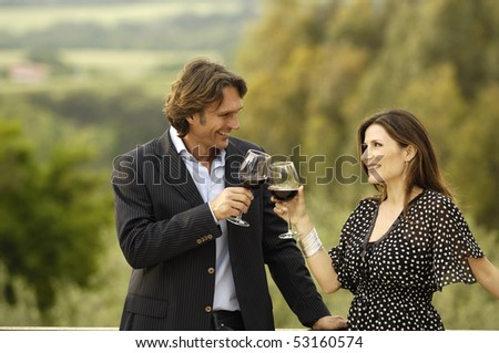 Nice couple celebrating with wine - stock photo