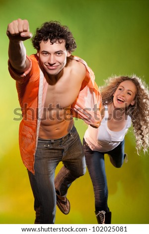 nice couple posing in studio - stock photo