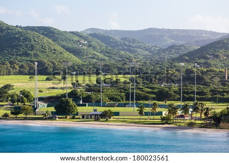 Nice cricket complex on the coast of St Croix with deep blue sea - stock photo