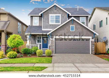 Nice curb appeal two level house stock photo 452715514 shutterstock for Exterior concrete driveway paint