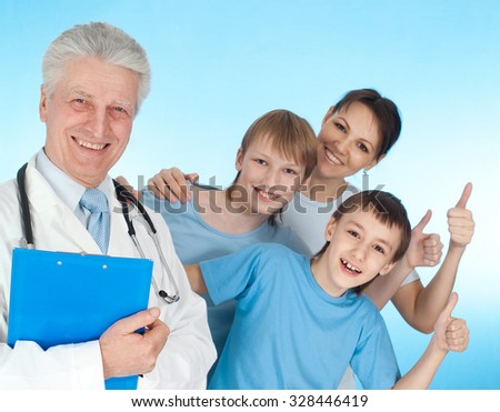 Nice doctor in a white coat with a stethoscope and patients with thumbs up - stock photo