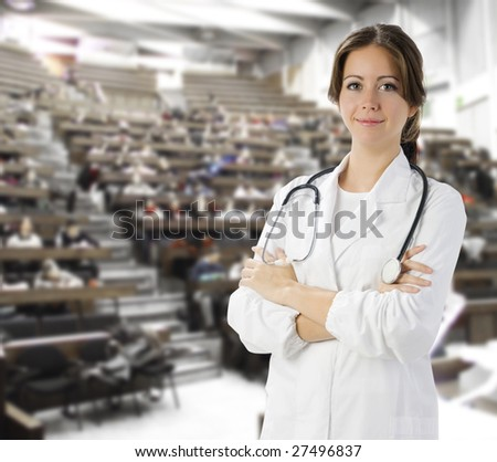 nice doctor in white medical gown and a stethoscope around her neck