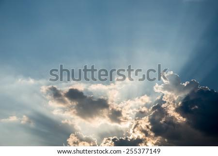 Nice drama sky with sun ray shining - stock photo