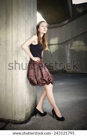 Nice dressed lady posing on location - stock photo